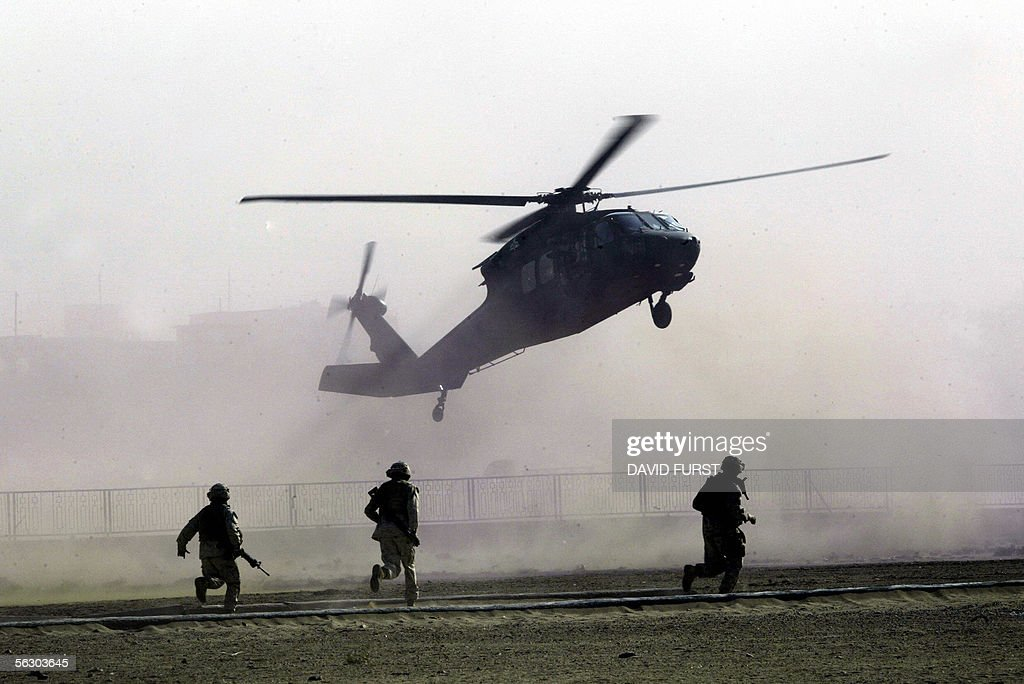 US Marines race to secure a landing zone : News Photo
