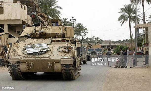 US soldiers patrol in the village of Bohroz 5 km south of Baquba 140 kilometers north of Baghdad 20 April 2005 US forces and Iraqi police conducted...