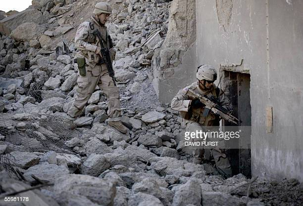US soldiers SPC Jack Ellis SGT Orion Marley from Delta company 1184 Infantry Regiment enter an abandoned bunker to perform a search during a patrol...