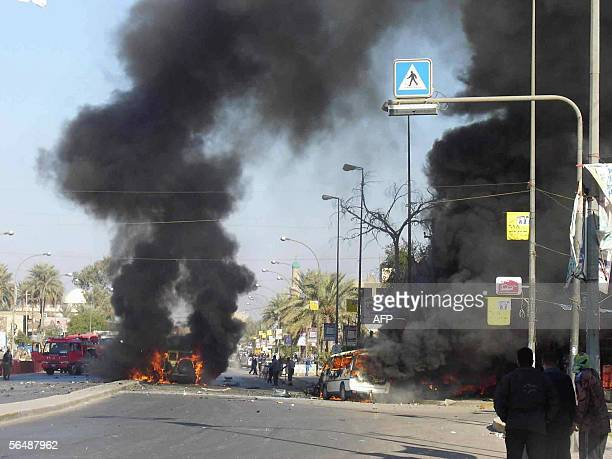 Vehicles burn following a car bomb in the Waziriyah district of Baghdad 26 December 2005 Four car bombs targeting police patrols exploded this...