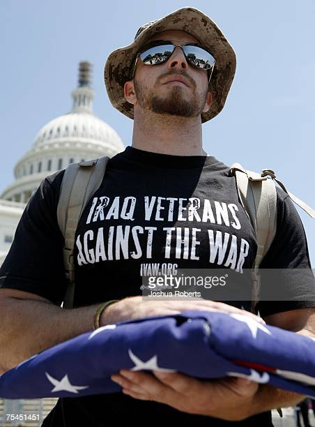 Iraq Veterans Against the War member Garett Reppenhagen holds a US flag in front of the US Capitol July 17 2007 in Washington DC Reppenhagen was part...