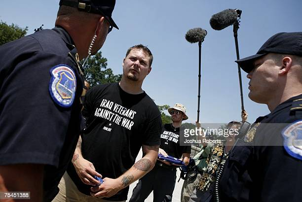 Iraq Veterans Against the War member Geoffrey Millard is stopped by US Capitol police at the US Capitol July 17 2007 in Washington DC Millard was...
