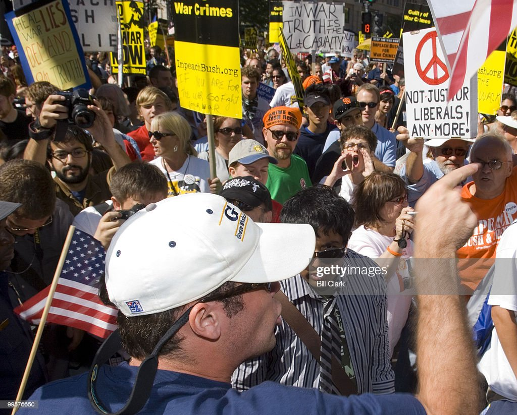 Iraq War protesters and counter protesters verbally clash along Pennsylvania Avenue in front of the Justice Department as the peace march made its way to the Capitol on Saturday, Sept. 15, 2007.
