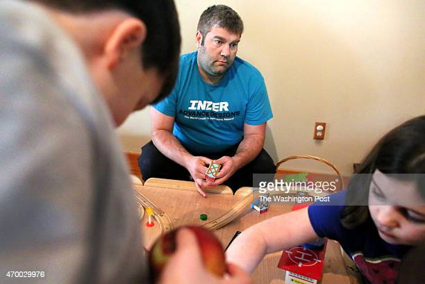 Iraq War veteran Jonah Hughes watches his children Haakon Hughes 5 and Evie Hughes play in the playroom of his home in Hartford CT on March 27 2015...