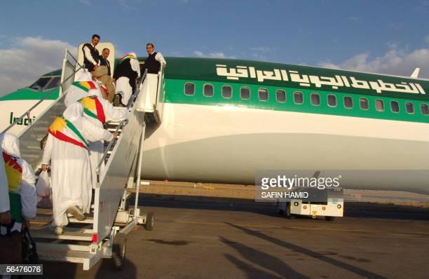 With the Kurdish flag sash Kurdish Muslim women get onto an Iraqi airways plane at Arbil's International Airport prior to departing to Jeddah in...