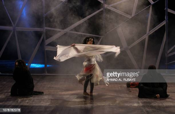 Iraqi actresses perform in a play entitled 'Girls of Baghdad' at the National Theater in central Baghdad on January 7 2019 The play depicts the fate...