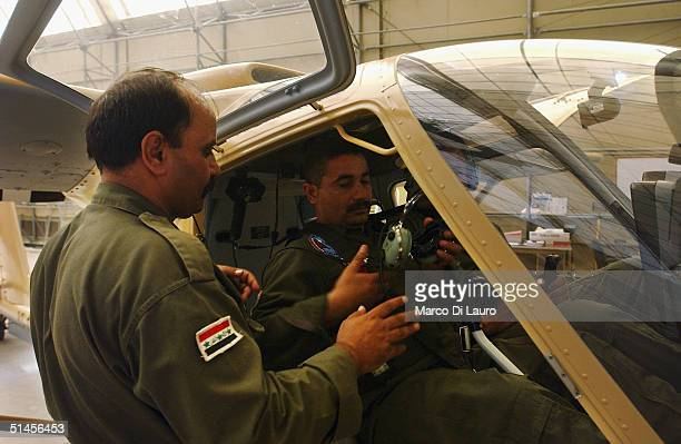 Iraqi Air Force pilots attend a training course with a Seabird SB17 Seeker aeroplane at the British Military Basrah Air Station October 9 2004 in...