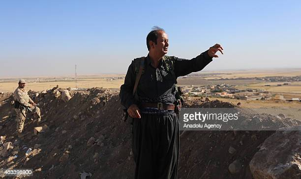 Iraqi air forces support Peshmerga forces as they clash with Islamic Stateled armed group members in Mosul Iraq on August 9 2014 According to Serbest...