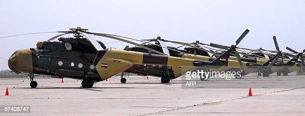 Iraqi Airforce Russianmade Mi17 helicopters sit parked on a tarmac at the new alMuthana Airforce base near Taji 20 kms north of Baghdad 22 April 2006...