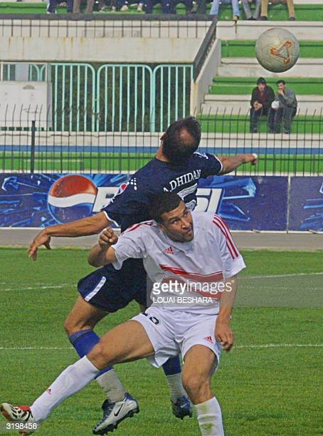 Iraqi alTalaba club player Ahmad Wali vies with Egyptian AlZamalek club player Tarek AlSaid during their Arab Champions League quarterfinal match in...