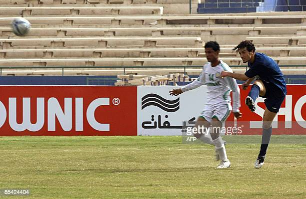 Iraqi alTalaba player kicks the ball past a Karbala player during their football match at alShaab stadium in Baghdad on March 14 2009 AFP PHOTO/ALI...