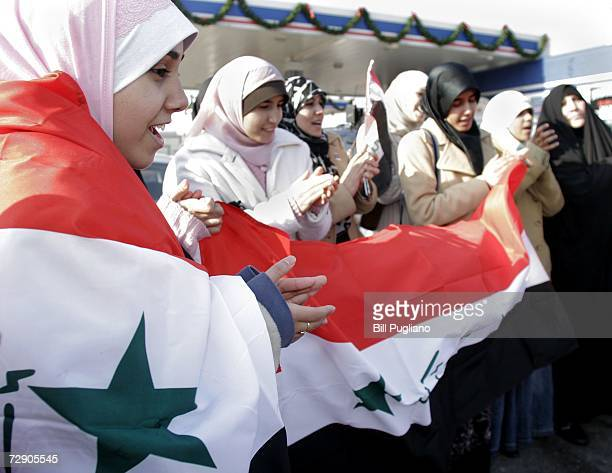 Iraqi American women celebrate the execution of former Iraq leader Saddam Hussein the morning after his death December 30 2006 in Dearborn Michigan...
