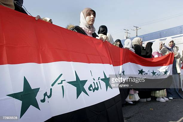 Iraqi American women celebrate the execution of former Iraqi leader Saddam Hussein the morning after his death December 30 2006 in Dearborn Michigan...