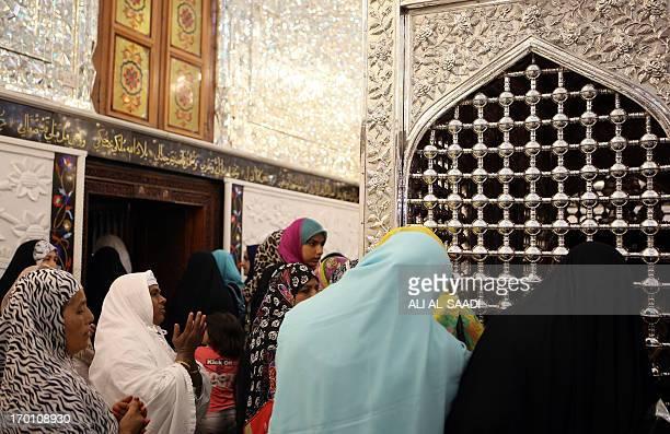 Iraqi and Asian female Muslim pilgrims pray at the shrine of the Sunni Sheikh Abdul Qadir alJilani in central Baghdad on June 7 2013 Attacks in Iraq...