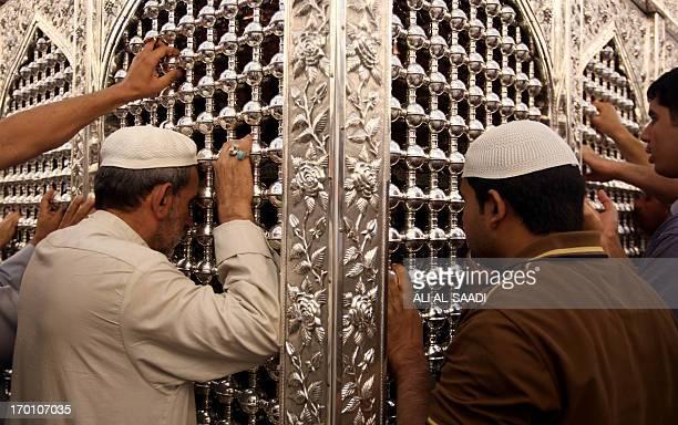 Iraqi and Asian Muslim pilgrims pray at the shrine of the Sunni Sheikh Abdul Qadir alJilani in central Baghdad on June 7 2013 Attacks in Iraq have...