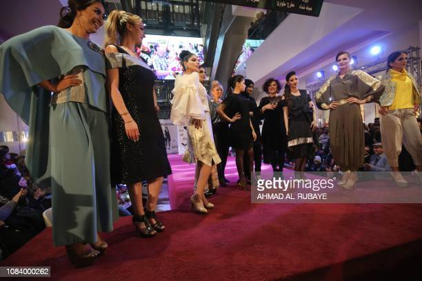 Iraqi and Iranian model and the Iranian fashion designers acknowledge the audience following a show at a shopping mall in the Iraqi capital Baghdad...