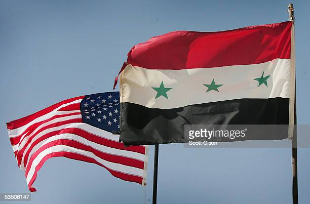 Iraqi and US flags fly over Al Asad air base August 29 2005 in Al Asad Iraq The base is used as a major deplyment hub for Marines and Soldiers coming...