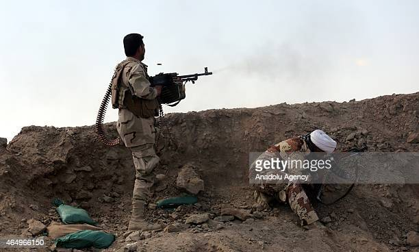 Iraqi Army and volunteer fighters take position as they launch an operation in Saladin Governorate against Daesh on March 2 2015