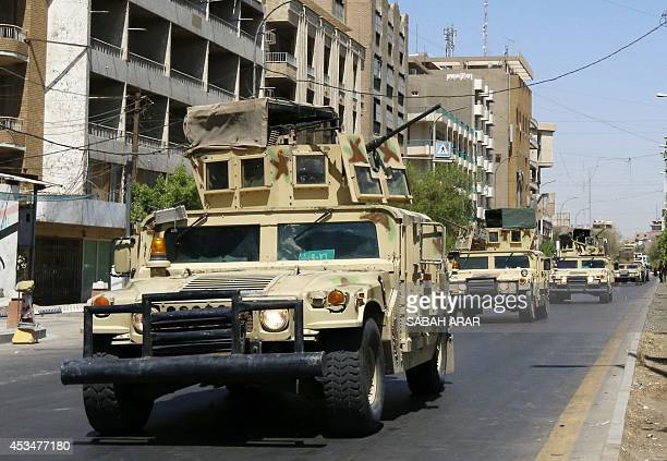 Iraqi army armoured vehicles patrol a street in Baghdad's commercial district of Karrada on August 11 2014 as security measures have been reinforced...