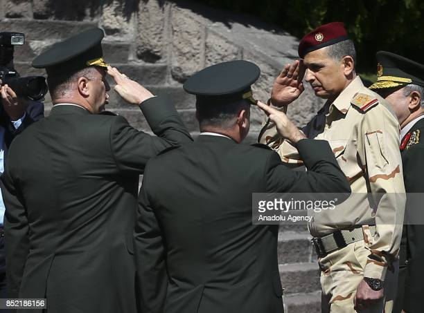 Iraqi Army Chief of Staff Gen Othman alGhanimi makes soldier salute during official welcome ceremony prior to his meeting with Turkish Chief of...