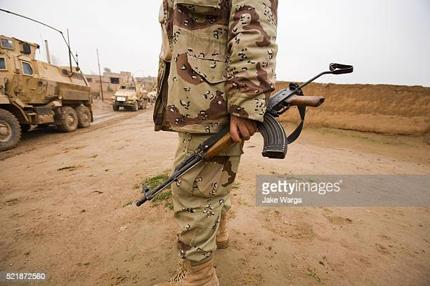 iraqi army soldier with old kalashnikov, ak, rifle - iraq stock pictures, royalty-free photos & images