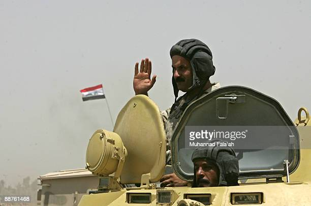 Iraqi army soldiers are seen on top of their tank waving as they celebrate the US withdrawal from Iraqi cities on June 30 2009 in Baghdad Iraq Iraq...