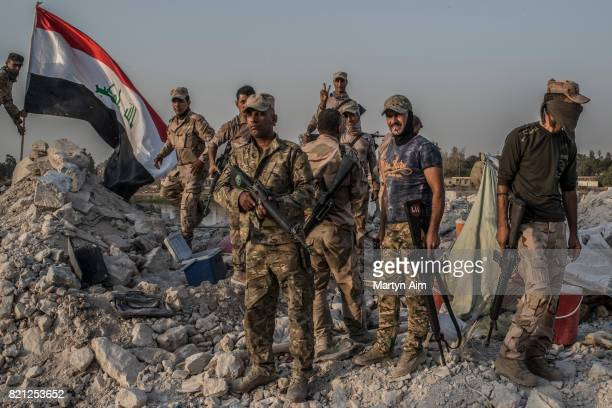 Iraqi Army soldiers beside the Tigris River in the destroyed Old City district on July 22 2017 in Mosul Iraq Despite the declared liberation of Mosul...