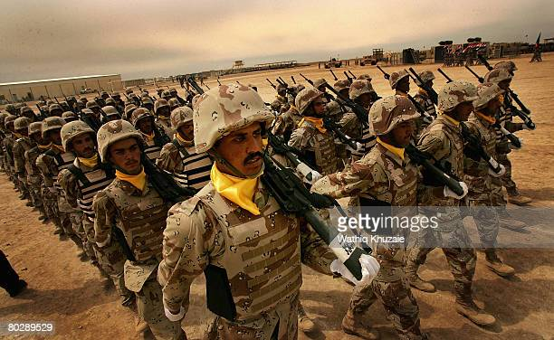 Iraqi army soldiers from the 4th Brigade of the 5th Division march in ranks during their graduation ceremony at Besmaya Range Complex on March 18...