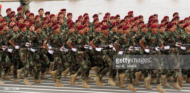 Iraqi army soldiers march during a parade to mark the 91st Army Day in Baghdad on January 6 weeks after US troops completed their pullout The Armed...