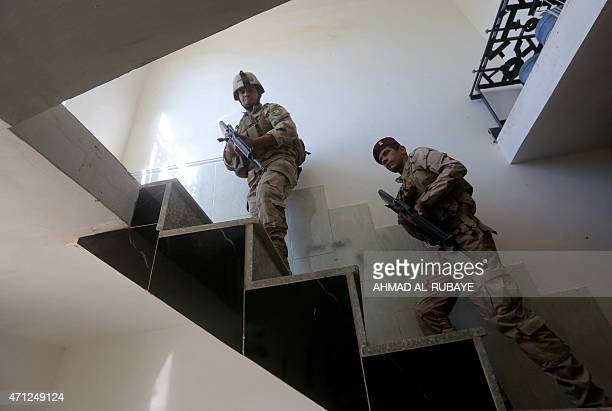 Iraqi army soldiers search a building in the Garma district west of the Iraqi capital Baghdad in the Anbar province's eastern edge on April 26 where...