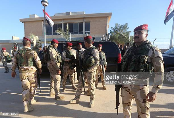 Iraqi army soldiers stand before a conference on fighting the Islamic State group attended by Iraq's tribal leaders militiamen and members of the...