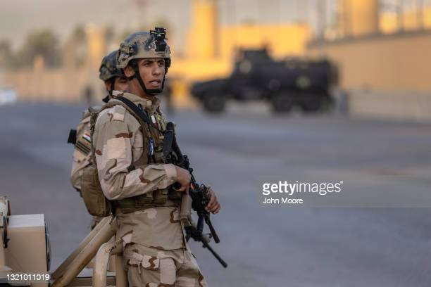 Iraqi Army soldiers stand guard on a road between the U.S. Embassy and the International Zone on May 30, 2021 in Baghdad, Iraq. Coalition forces...