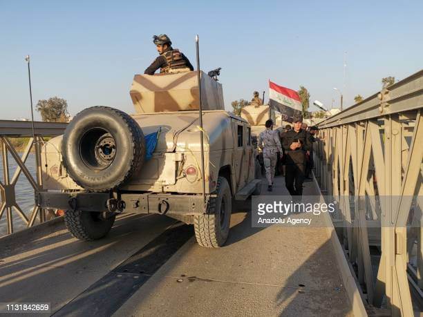 Iraqi army take security measures around the site after a ferryboat sank in Iraqs Tigris River on Thursday, leaving at least 55 people dead and more...