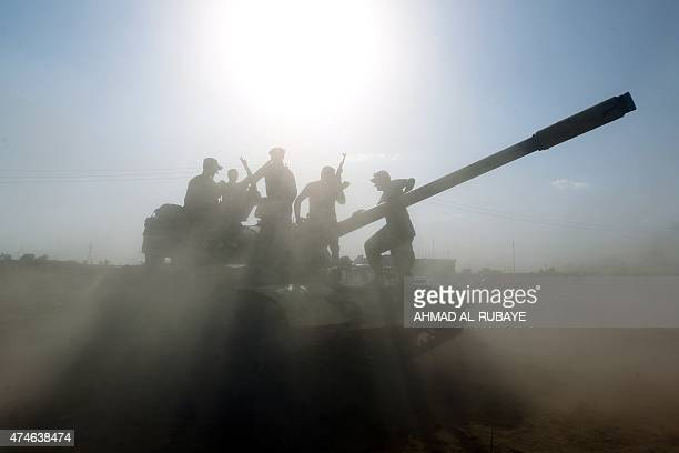 Iraqi army tanks get into position on the outskirts of Baiji refinery north of Tikrit during a joint operation between the army and popular...