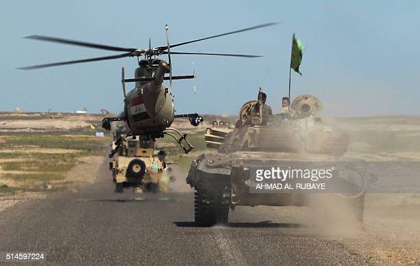 Iraqi army vehicles and a helicopter deploy in the front line in alAnbar desert 50 kms north east of Haditha where the country's forces are fighting...