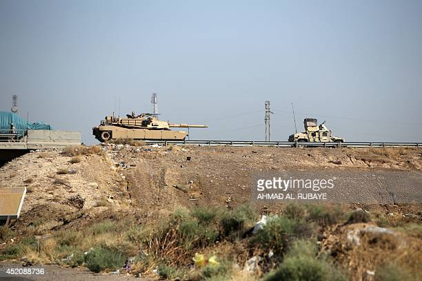 Iraqi army vehicles are seen on a road in the town of Samarra in Salaheddin province on July 12 2014 Iraqi forces and tribal fighters beat back a...