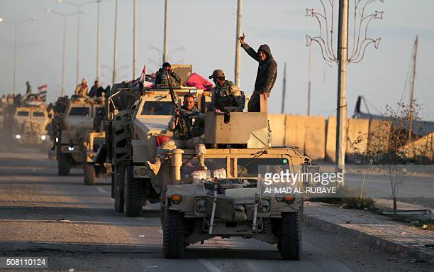 Iraqi army's soldiers on their armoured vehicles drive on February 2 2016 towards alSajariyah area east of the city of Ramadi the capital of Iraq's...