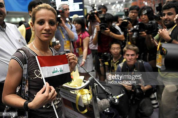 Iraqi athlete Dana Hussein at Beijing's Capital International Airport late August 4 2008 Iraq's compact Olympic contingent was cleared on July 29 to...
