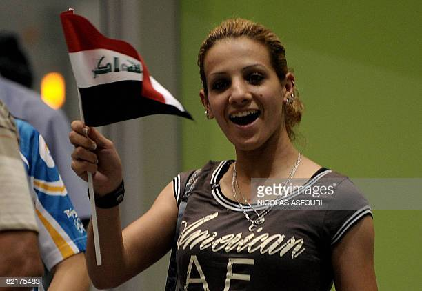 Iraqi athlete Dana Hussein waves her national flag at Beijing's Capital International Airport late August 4 2008 Iraq's compact Olympic contingent...