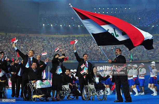 Iraqi athletes parade during the opening ceremony of 2008 Paralympic Games in Beijing on September 6 2008 at the National Stadium also known as the...