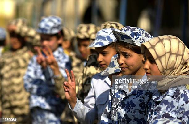 Iraqi Baath Party youth attend a soccer match for Iraqis and Western human shields March 15 2003 in Baghdad Iraq Scores of human shields have come to...