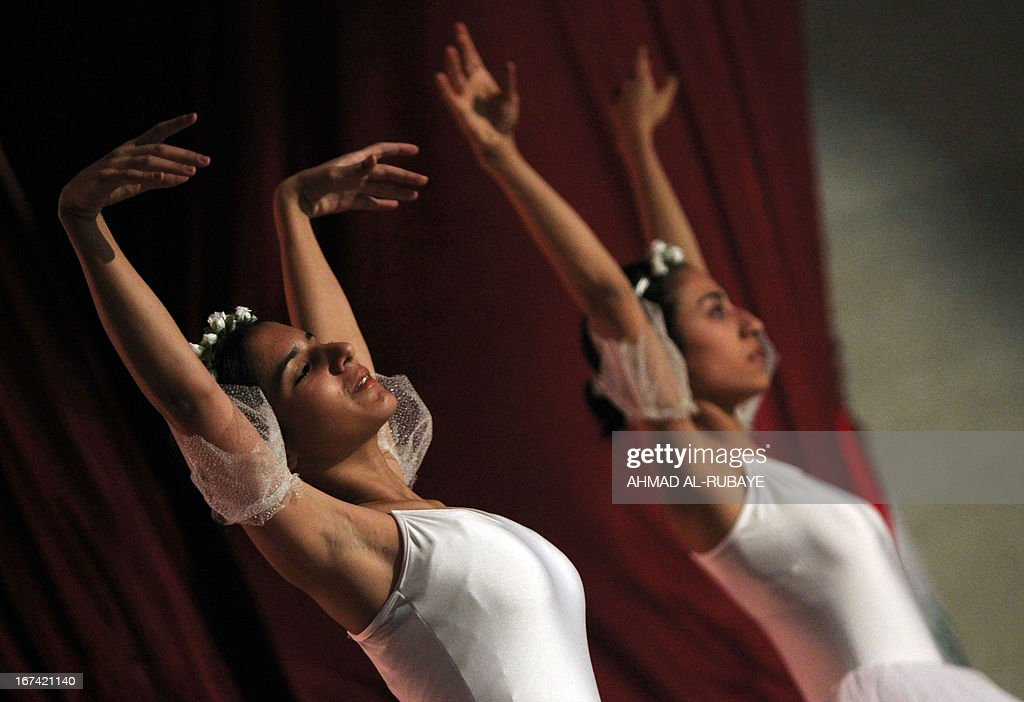 Iraqi ballet dancers from the ballet and music school, perform during their annual production that marks the end of the school year, at al-Ribat hall theatre in central Baghdad on April 25, 2013.