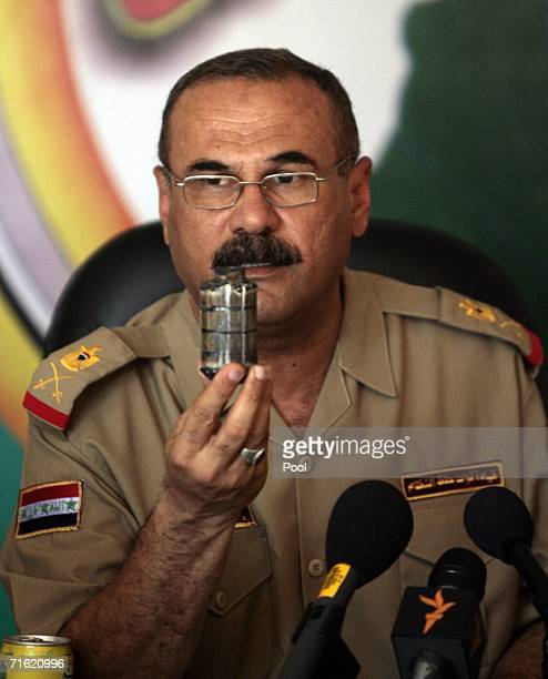 Iraqi BG Abdel Karim Abdel Rahman Yussef commander 6th brigade 2nd Iraqi national police shows the journalist a grenade during a joint press...