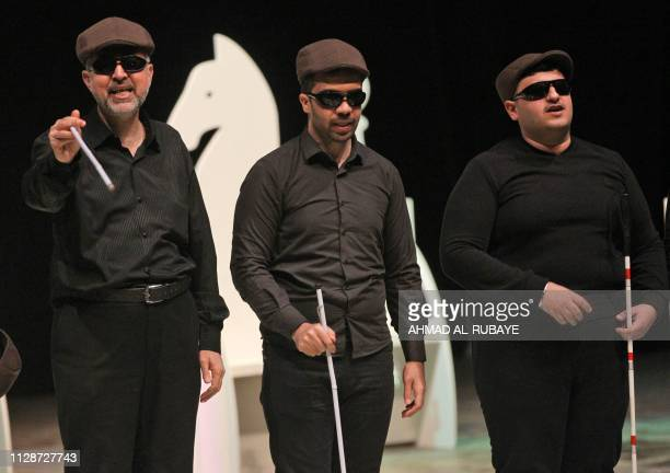 Iraqi blind actors perform a play entitled 'OverProva' on the stage of the National Theatre in Baghdad on March 1 2019 The play is a political...