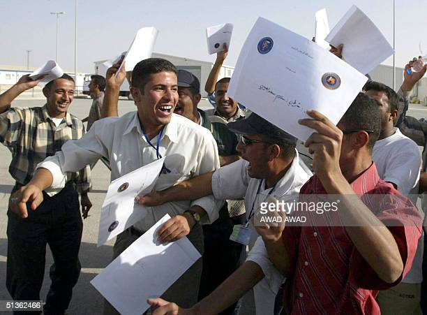 Iraqi border guards wave their diplomas completing a USled training course in Moaqar camp south east of Amman 27 September 2004 The 458 cadets were...