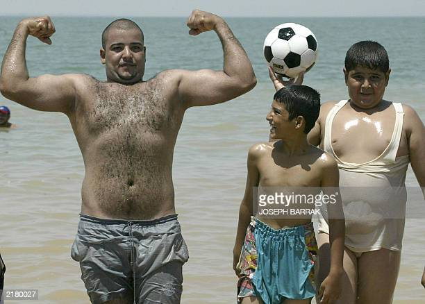 Iraqi boys goof around on the beach at AlHabbaniyah resort 20 kms outside of the flashpoint town of Fallujah where temperatures soared to 45 degrees...