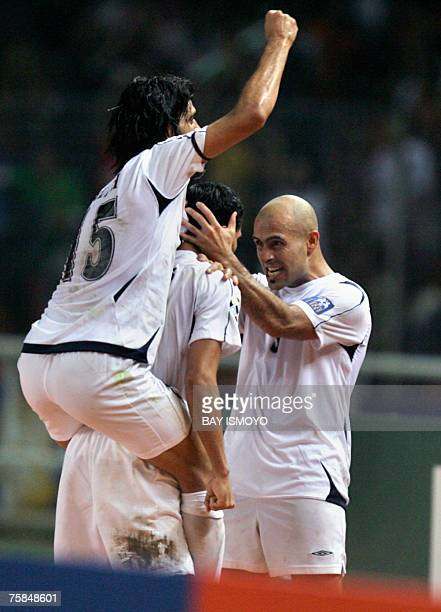 Iraqi captain Younis Mahmoud celebrates with teammates after scoring a goal against Saudi Arabia during the final match of the Asian Football Cup...