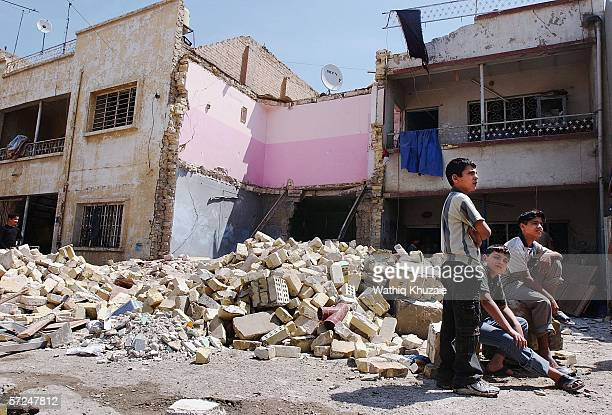 Iraqi children are seen in front of a destroyed house on April 4 2006 in Baghdad Iraq A bomb exploded inside the house killing two children and...