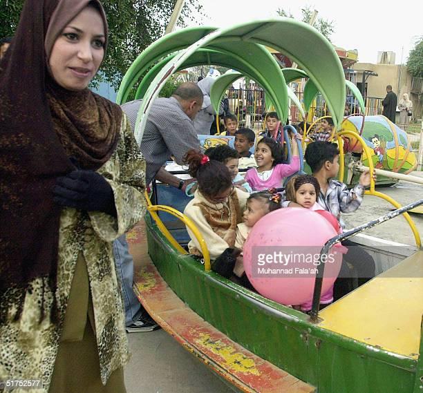 Iraqi children celebrate the last day of Eid alFitr November 16 2004 in Baghdad Iraq The husband of BritishIraqi aid worker Margaret Hassan said on...