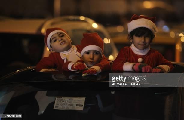 Iraqi children celebrate the New Year January 1 2019 in Baghdad